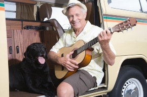 man with guitar and dog